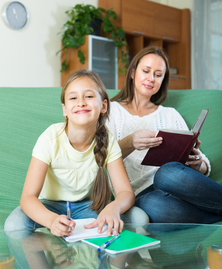 Mother with daughter doing homework royalty free stock photo