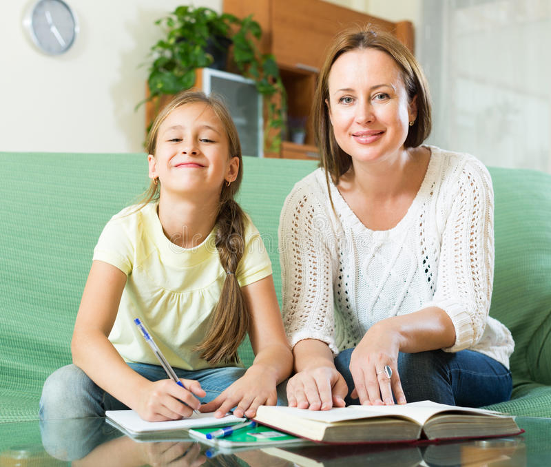 Mother with daughter doing homework stock photography