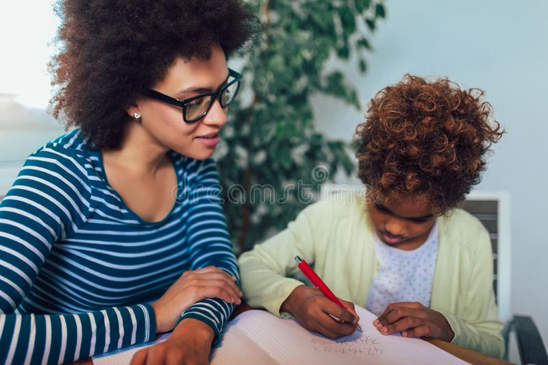 Mother and daughter doing homework learning to calculate royalty free stock images