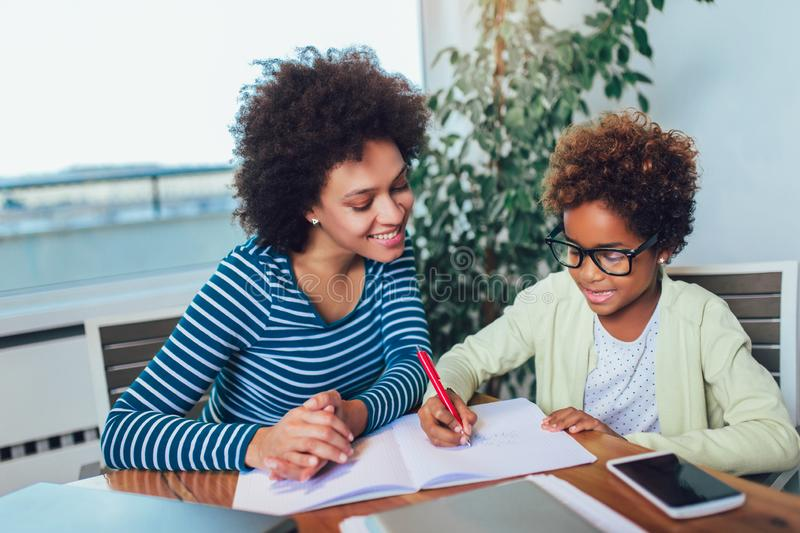 Mother and daughter doing homework learning to calculate royalty free stock image