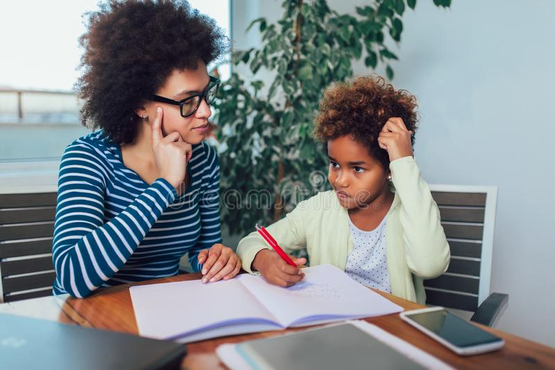 Mother and daughter doing homework learning to calculate royalty free stock photography