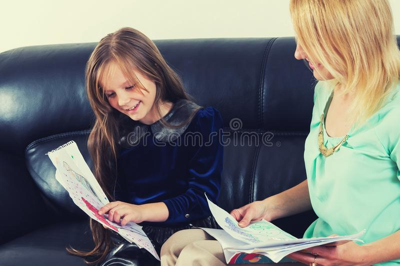 Mother and daughter doing the homework stock photography