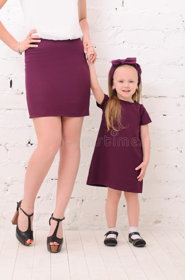 mother with daughter dressed family look stock image