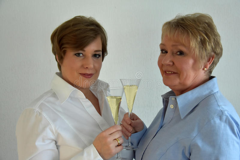 Mother and daughter. Drinking sparkling royalty free stock image