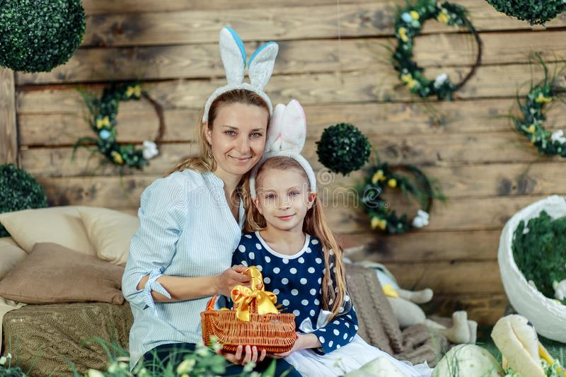 Mother and daughter with Easter eggs. Happiness, cute stock photography