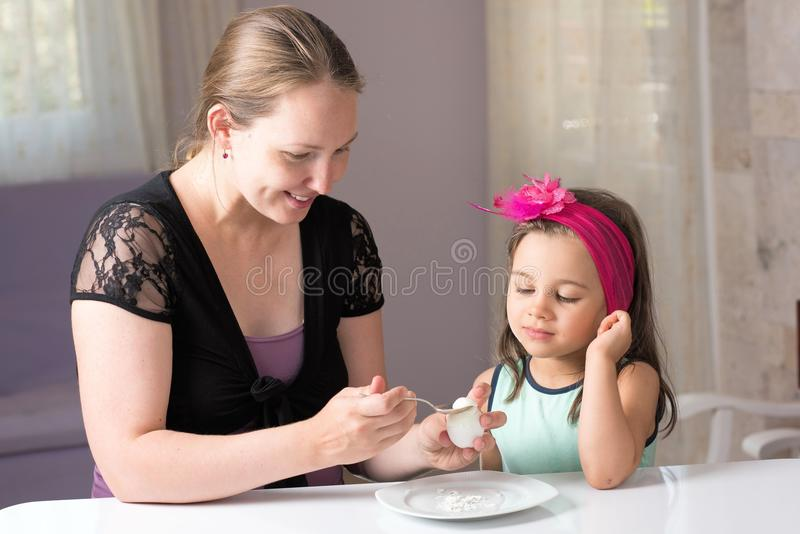 Mother and Daughter Eating Egg royalty free stock photo