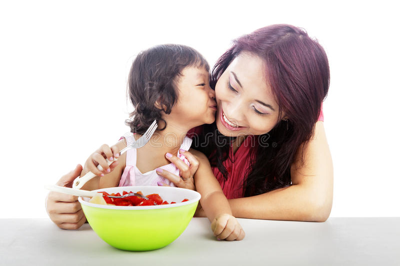 Download Mother And Daughter Eating Fruit Salad Stock Image - Image of chinese, female: 25197585