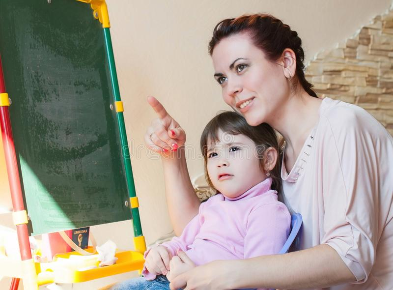 Mother with the daughter, education stock photos
