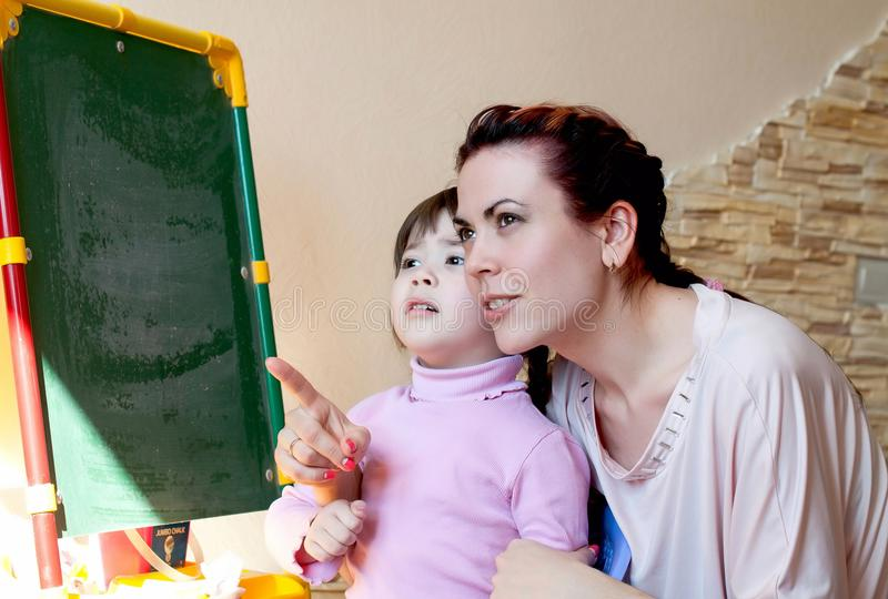 Mother with the daughter, education stock images
