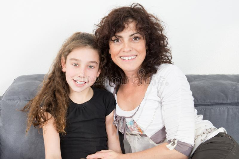 Mother and daughter enjoy in sofa at home and looking royalty free stock images