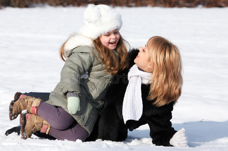 Download Mother And  Daughter Enjoying Beautiful Winter Day Stock Photo - Image: 22989722