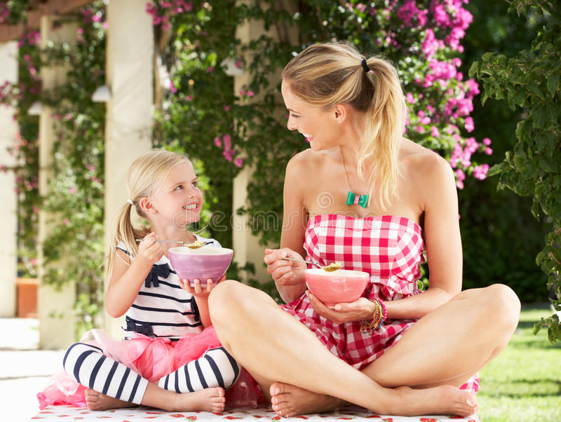 Mother And Daughter Enjoying Breakfast Together Royalty Free Stock Photo