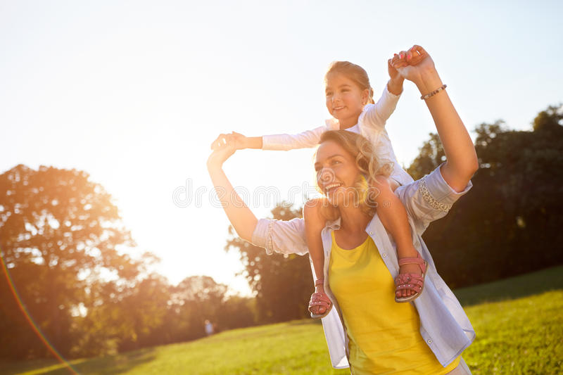 Mother with daughter enjoying in nature royalty free stock image