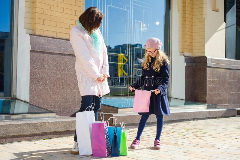 Mother And Daughter Enjoying Shopping Trip Together royalty free stock photography