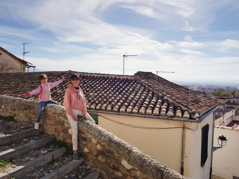 Mother and daughter enjoying the views of Granada from the Realejo neighborhood. stock image