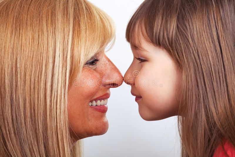 Mother and daughter eskimo kiss royalty free stock photos