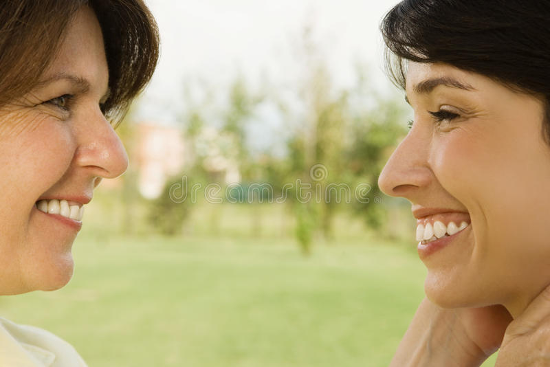 Mother and daughter face to face royalty free stock photos