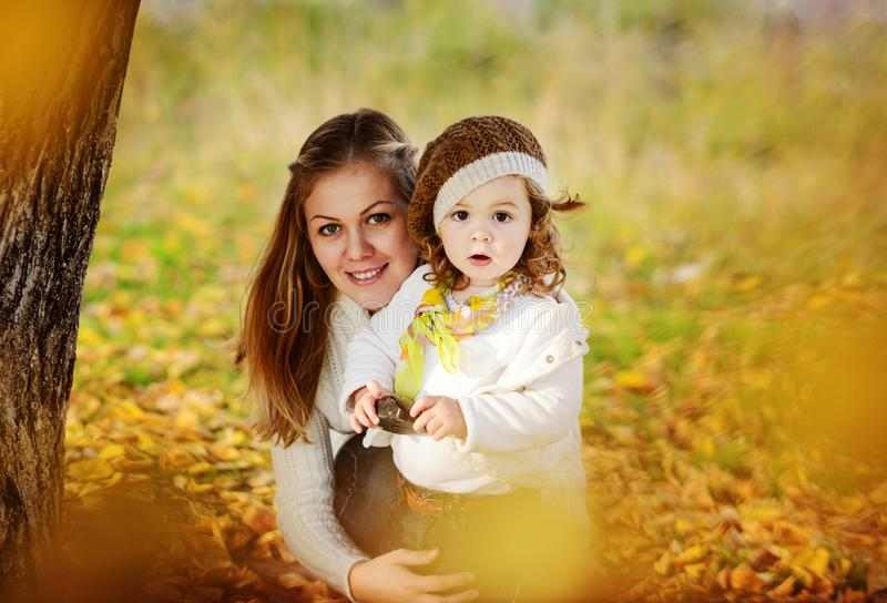 Mother and   daughter in fall stock image