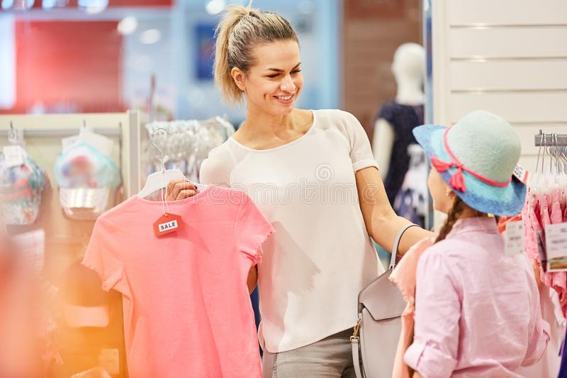 Mother and daughter at the fashion shop stock photography