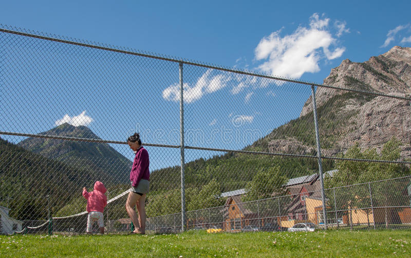 Download Mother And Daughter At Fence Stock Photo - Image: 26628778