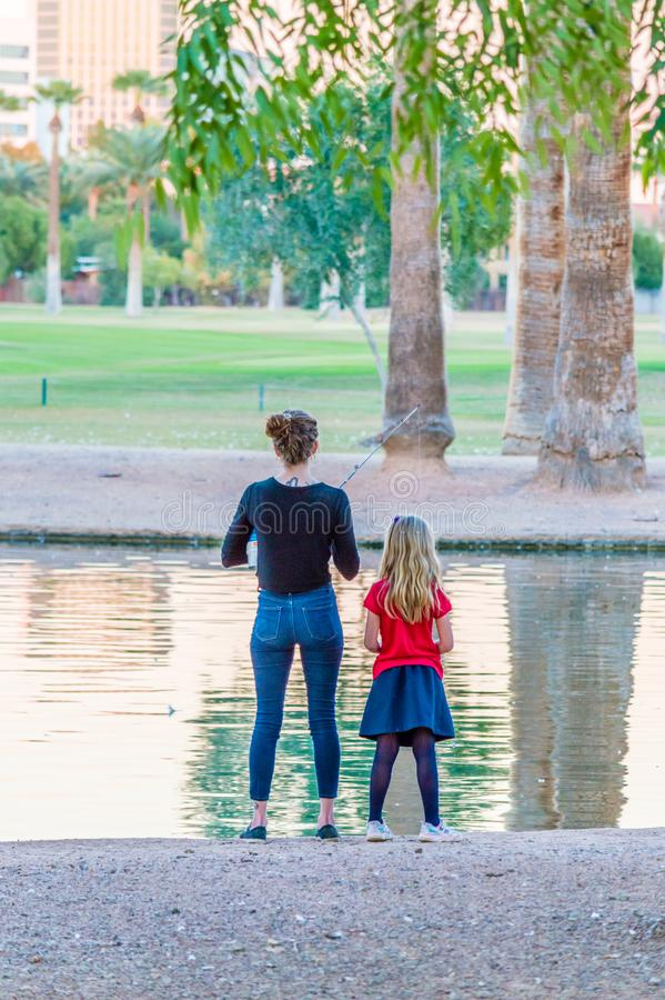 Mother and Daughter Fishing royalty free stock image