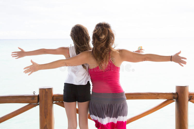 Mother and daughter freedom on the beach royalty free stock images