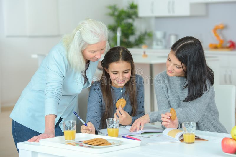 Mother and daughter with granddaughter in kitchen royalty free stock image