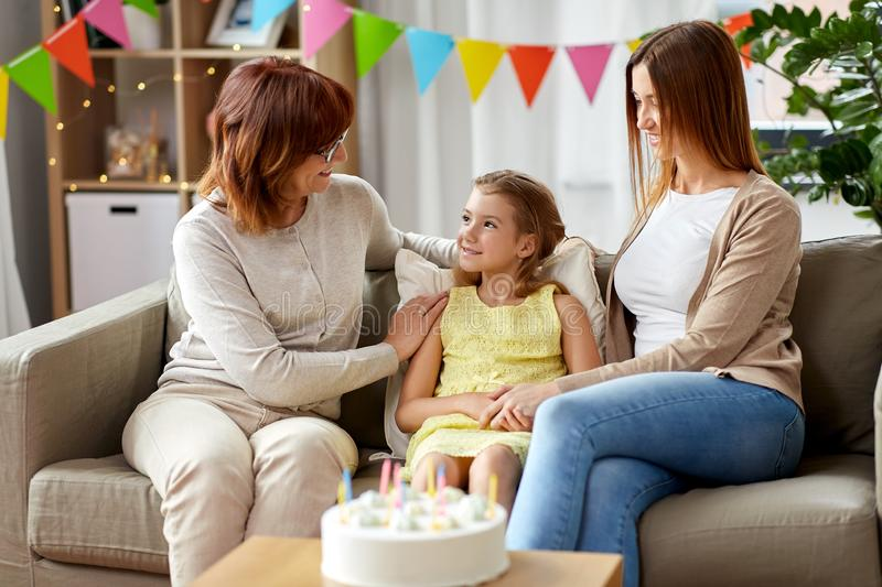 Mother, daughter and grandmother at birthday party royalty free stock photos