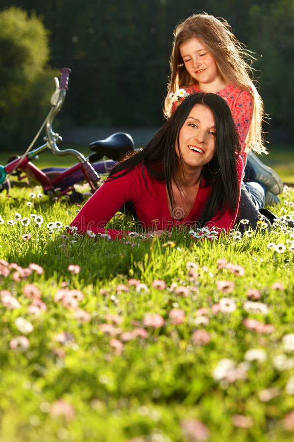 Mother and daughter on a grass royalty free stock photos