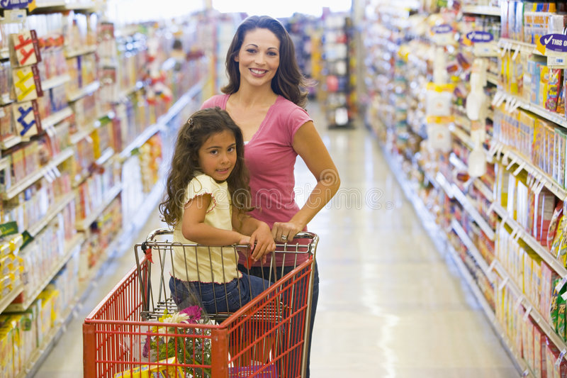 Mother and daughter grocery shopping royalty free stock photo