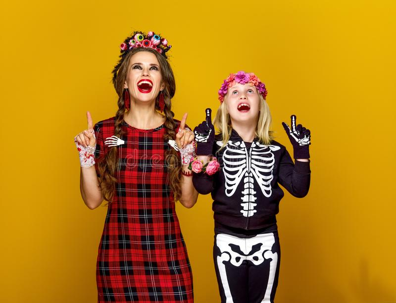 Download Mother And Daughter In Halloween Costume Pointing At Something Stock Photo - Image of autumn  sc 1 st  Dreamstime.com & Mother And Daughter In Halloween Costume Pointing At Something Stock ...