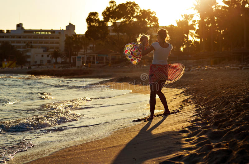 Mother and daughter are happy at sunset in Cyprus royalty free stock images