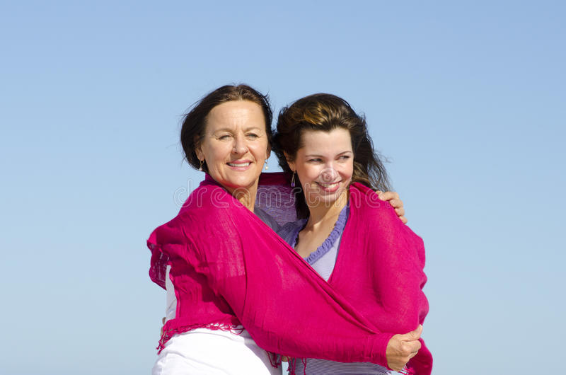 Mother and daughter happy together stock photos