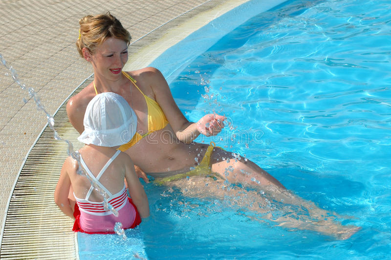 Download Mother And The Daughter Have Fun At Pool Stock Image - Image: 10611355