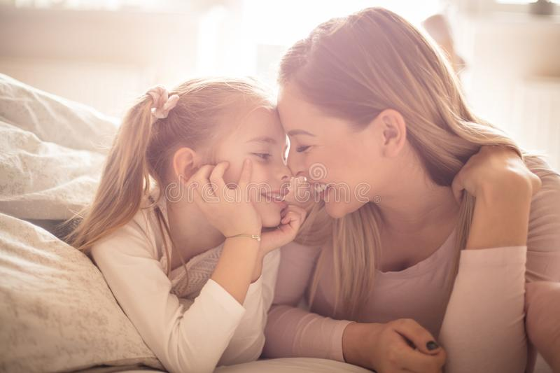 Mother and daughter have a strong connection stock photos