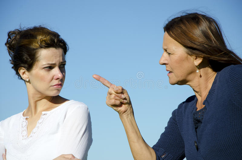 Mother and daughter having an argument stock photos