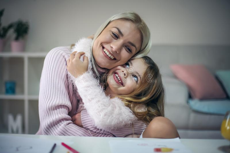 I love you mommy. Mother and daughter at home. royalty free stock photography