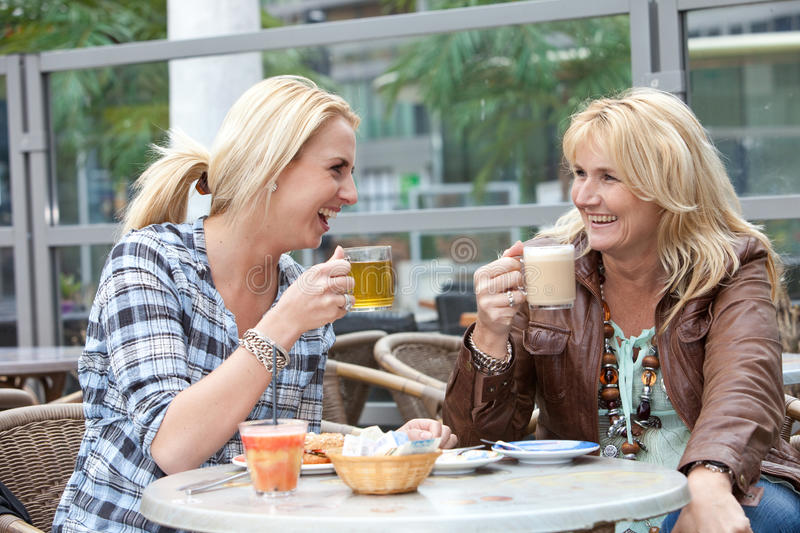 Download Mother And Daughter Having Fun Stock Photo - Image of beauty, table: 13673252