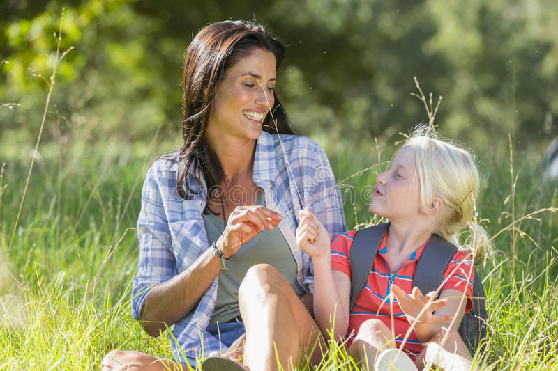 Mother And Daughter Having Fun On Countryside Hike royalty free stock photography
