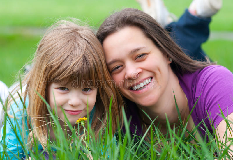 Mother and daughter having fun in the grass royalty free stock photo