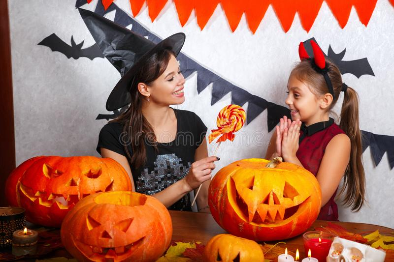 Funny Mother and daughter having fun at home. Happy family preparing for Halloween. People wearing carnival costumes. Mother and daughter having fun at home royalty free stock photo