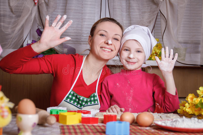 Mother and daughter having fun in kitchen stock photos