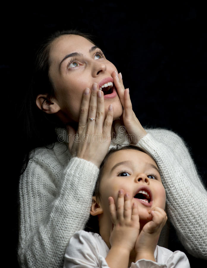 Mother and daughter having fun showing they are scared isolated stock photos