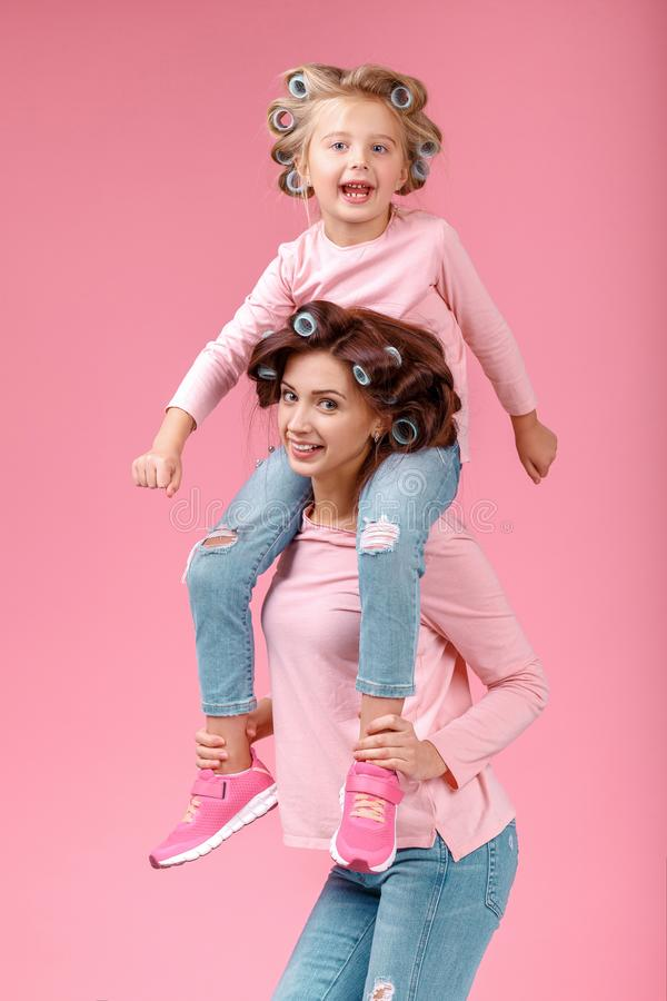 Mother and daughter having fun together stock images