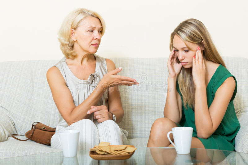 Mother with daughter having serious conversation stock image