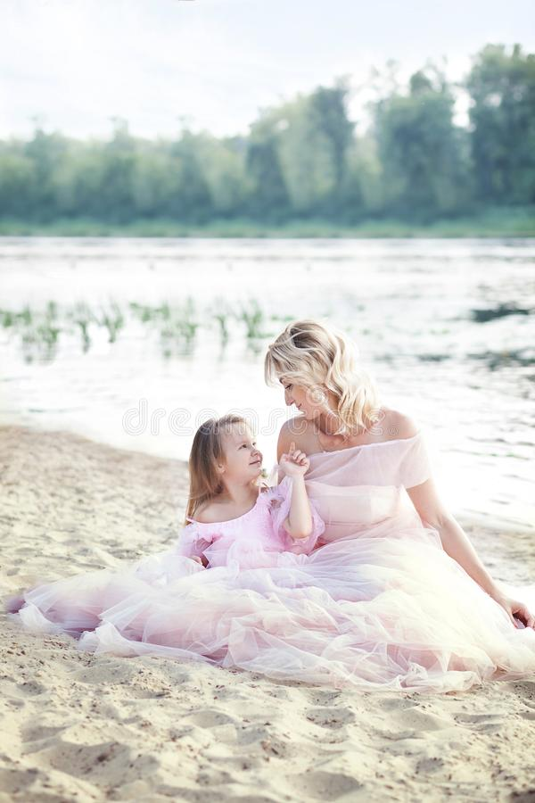 Mother and daughter having tender moments outdoor. Mum enjoying time with her kid in vacation holiday. Family lifestyle, travel, f stock images