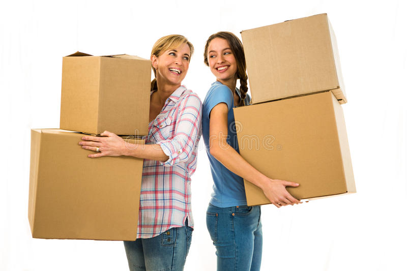 Mother and daughter holding boxes stock photo