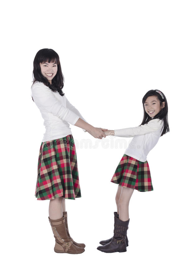 Mother and daughter holds hands each other royalty free stock photos