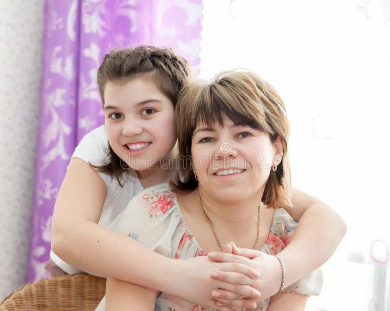 Mother and daughter at home royalty free stock images