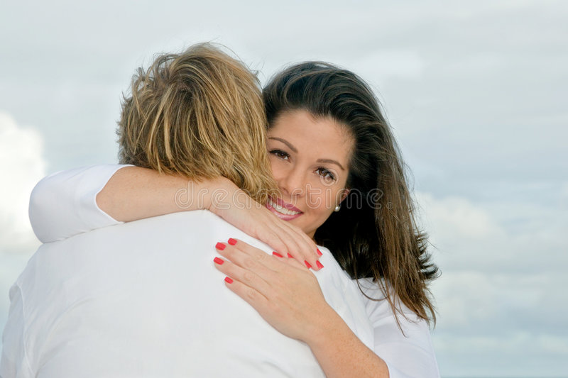 Mother and daughter hug stock photography